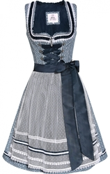 dirndl knee-length in navy blue cotton with allover muted white small scale damask print, neckline is trimmed with navy pleated ribbon and white lace.  Apron is a dotted white soft mesh lace fabric with lace, braid, and ribbon trim around the hemline.