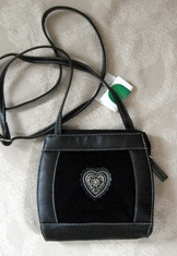 Black leather and suede trachten purse with metal heart detail.